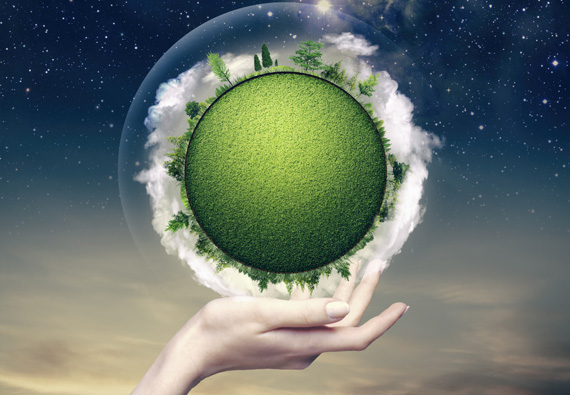 Green planet into the human hand
